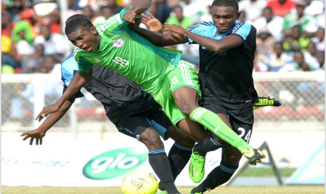 Flying Eagles striker, Taiwo Awoniyi (18) meandering through Kano Pillars defends at the ongoing Super Four tourney in Abuja