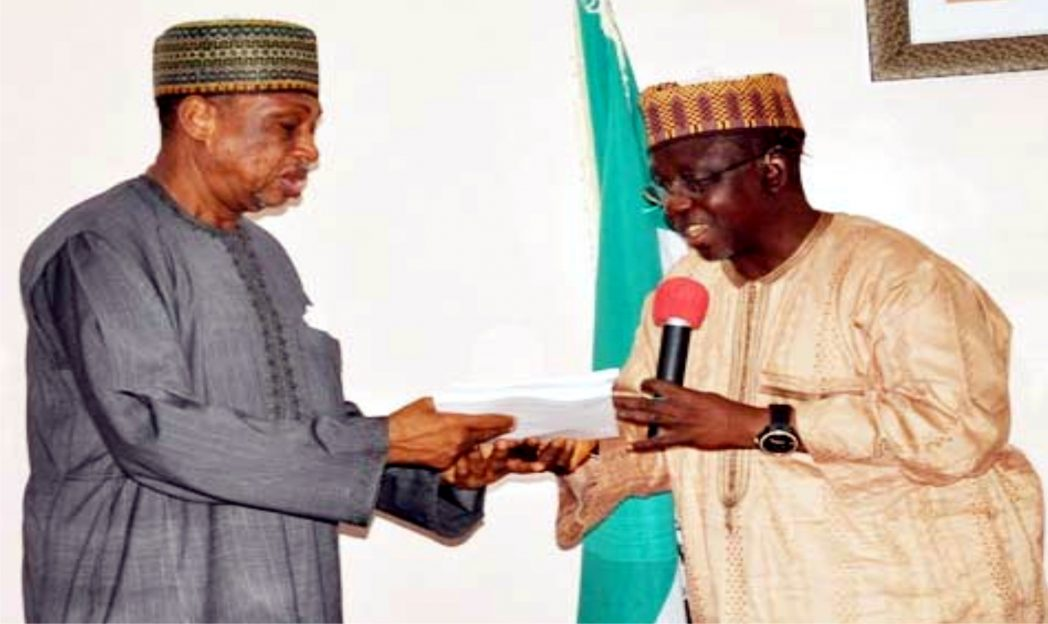 Chairman, Senate Committee on Security and Intelligence, Senator Mohammed Magoro (left), receiving copies of White Paper on  the Judicial Commission of Inquiry into Alakyo killings in Lafia.