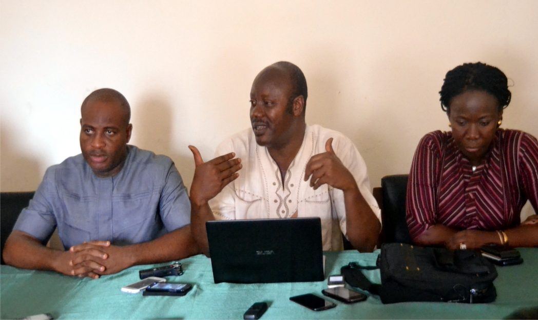 Rivers State (NUJ) Chairman, Mr Opaka Dokubo (middle) addressing pressmen, during a briefing on governorship candidates debate by Advocacy for  Violence free  2015 elections at the NUJ temporary state secretariat, Port Harcourt, yesterday.With him is Public Affairs Analyst, Mr Biobele E. Arimie (left) and RATTAWU Chairman, Opi Erekosima