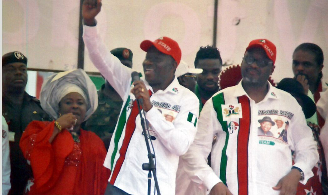 President Goodluck Jonathan (middle) addressing supporters at Adokiye Amiesimaka Stadium, Port Harcourt, during a campaign rally last Wednesday. He is flanked by PDP National Chairman, Adamu Mu'azu (right) and Dame Patience Jonathan (left).            Photo: Chris Monyanaga
