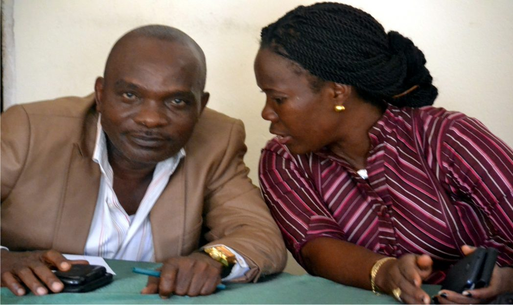 Rivers State RATTAWU chairman, Mrs Opi Erekosima chatting with chairman of RIVPAD, Mr Dimkpa C. Elikor, during a press briefing on governorship candidates debate by Advocacy for Violence-Free 2015 Election, in Port Harcourt.