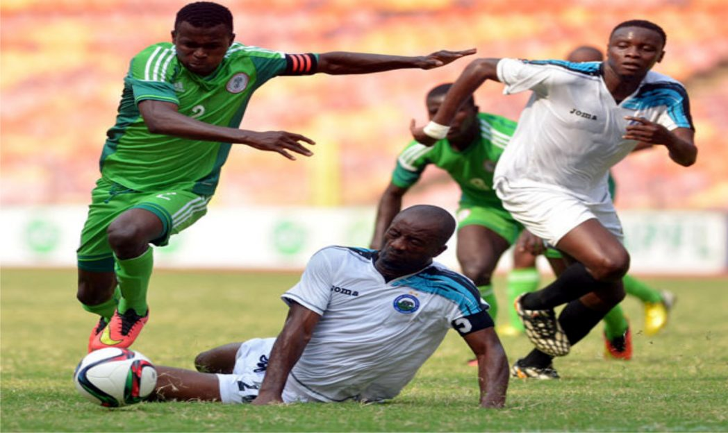 Enyimba's Captain, Chinedu Udoji (middle) trying to stop flying Eagles during their opening encounter at the Super 4 tournament