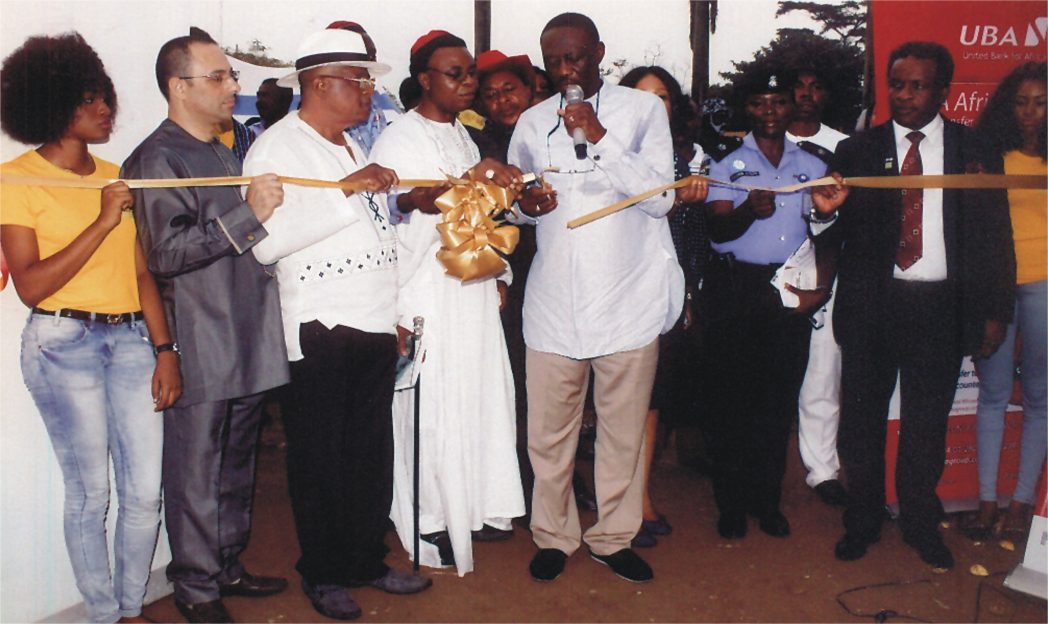 Former PHCCIMA President and FOSSCCIMA President, Prince Billy Gillis Harry, representing NACCIMA President, Alhaji Mohammed Baduru, (middle) cutting a tape for official opening of 2014 Trade Fair recently at Isaac Boro Park Port Harcourt. With him are President PHCCIMA, Engr. Emeka Unachukwu (right), former president PHCCIMA, Dr. Vincent Furo 2nd (left) and Chief Nabil Saleh (left).                Photo: Egberi A. Sampson