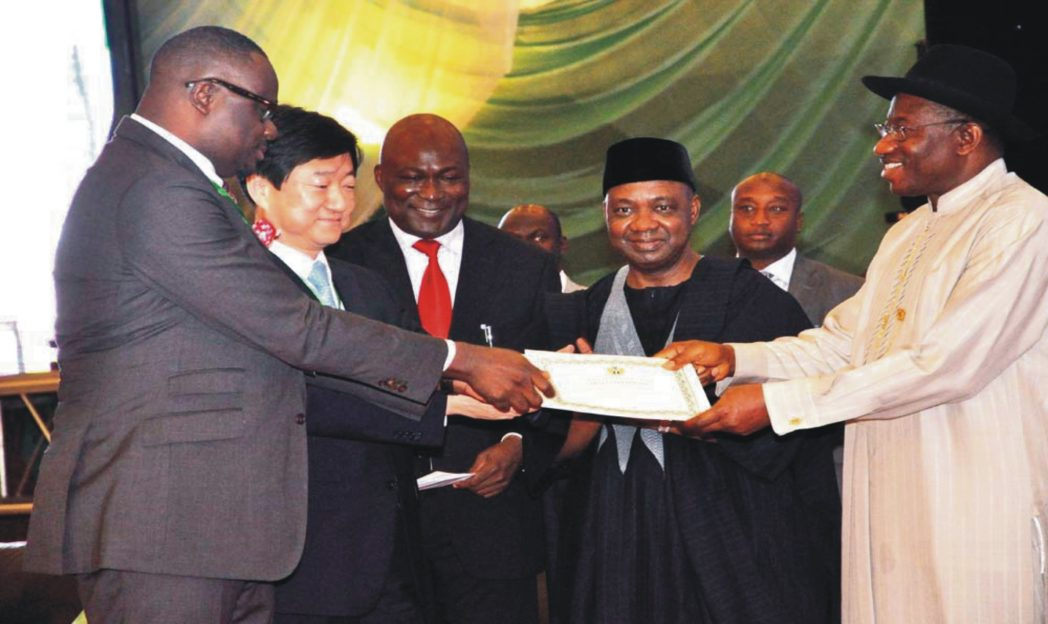 President Goodluck Jonathan (right), Vice-President Namadi Sambo (2nd right), presenting certificates and licences to new core owners of Phcn Successor Companies, Mr Kola Adesina Of Sahara Group (left) and the Managing Director, Korea Electronic Power Corporation, Mr So Taisup (2nd left) in Abuja recently. With them is the Director-General, Bureau for Public Enterprises, Mr Benjamin Dikki.
