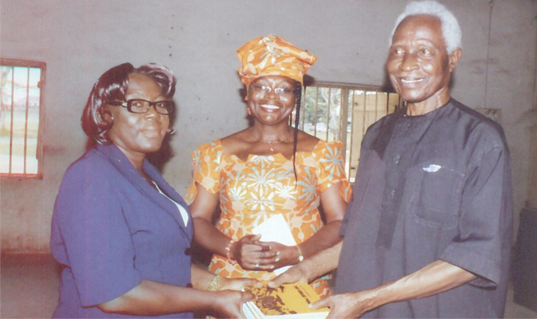 Dr Elechi Amadi (right) presenting copies of Rivers State-commissioned free books to the principal of GGSS, Rumuokwuta, D.C Bakel, on Monday. With them is wife of the author of the free literature text book, Dr Priye Iyalla Amadi.                                                                                                                                 Photo: Egberi Sampson