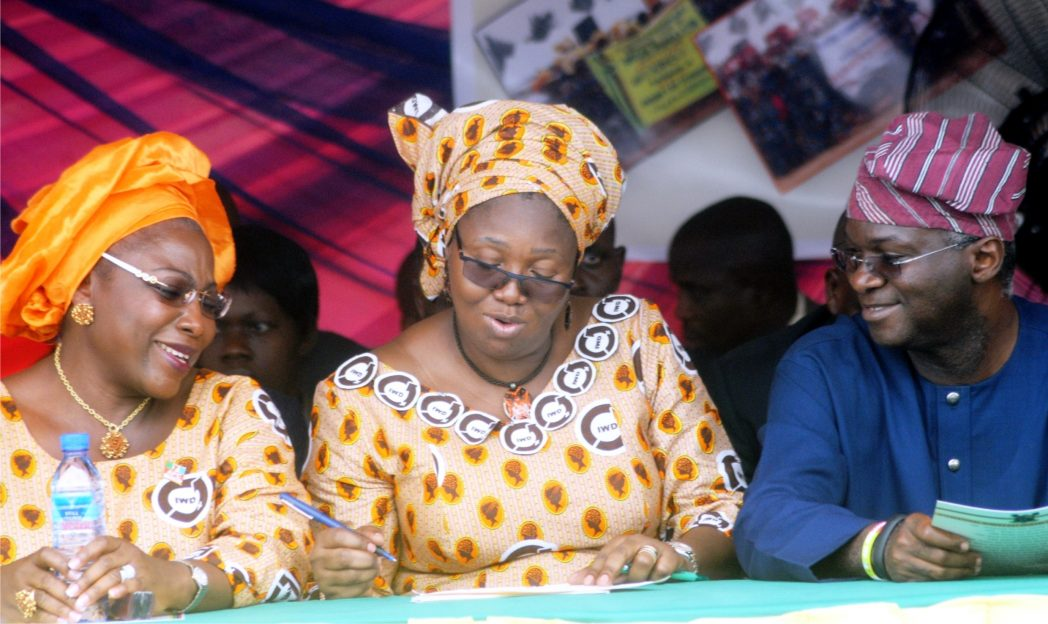 L-R:  Former Lagos Deputy Governor, Mrs Adebisi Sosan, wife of Lagos State Governor, Mrs Abimbola Fashola and  Governor Babatunde Fashola of Lagos State at the International Women's Day in Lagos, recently.