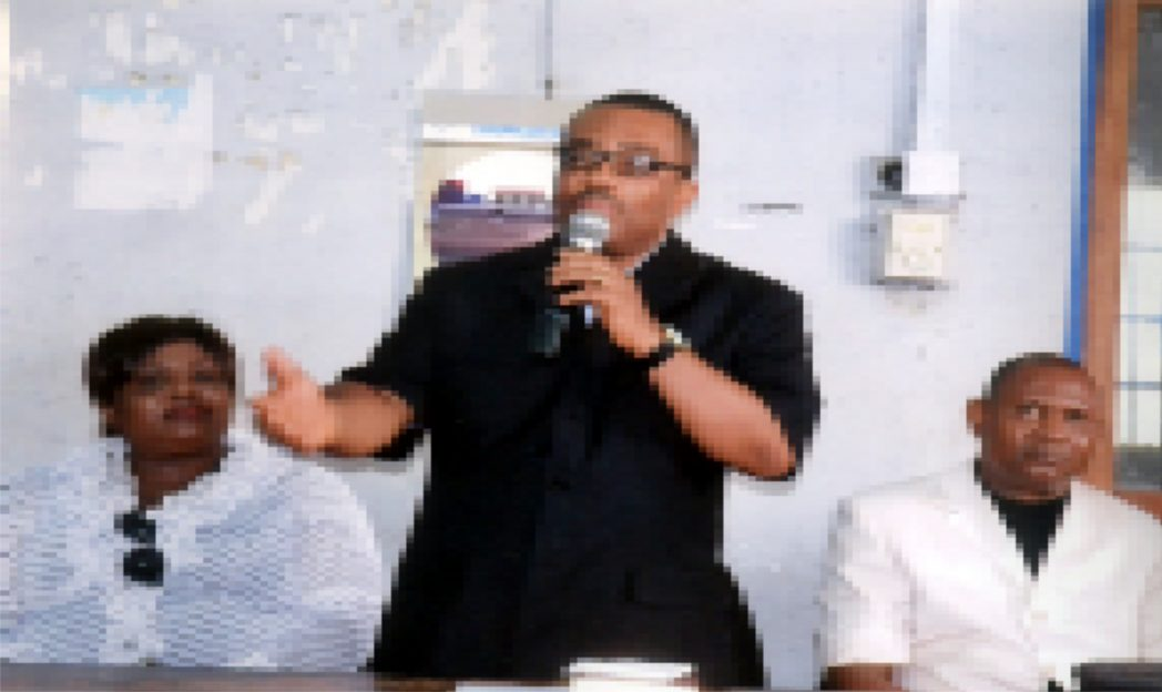 General Manager, Rivers State Newspaper Corporation, Mr Celestine Ogolo (middle), addressing staff of the corporation, during the 2015 Dedication Service of the corporation in Port Harcourt, yesterday. With him are Pastor Nimah Simon Neebari (right) and Director, Publications, Mrs Juliet Njiowhor. Photo: Egberi A. Sampson