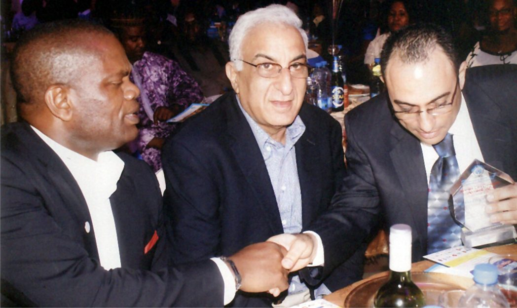 Executive Director, MCC Nigeria Ltd, Mr. Nelson Jaja (left) in a handshake with Chief Nabil Saleh (right), during the Garden City Corporate Award in Port Harcourt recently. With them is Mr. Saleh Habib.       Photo: Egberi A. Sampson