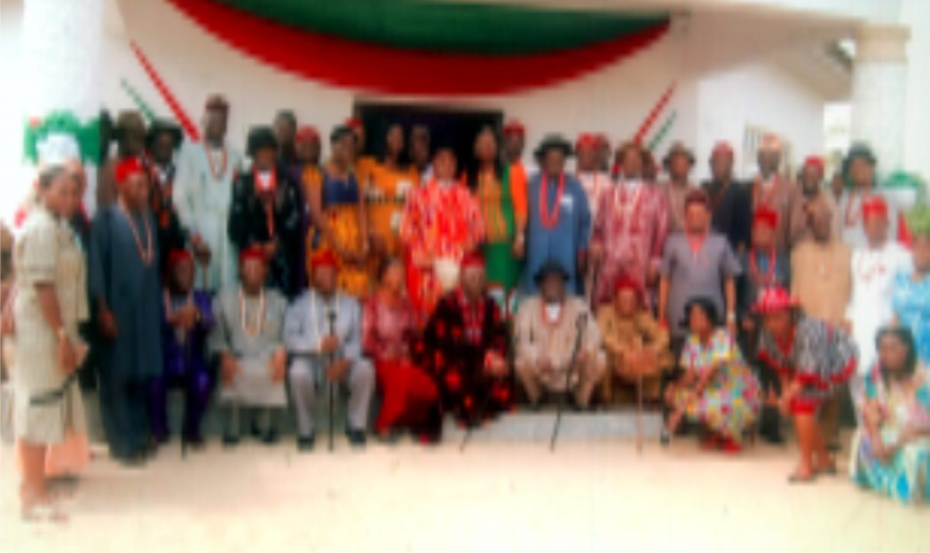 HRM Eze Dr. Samuel Amaechi poses with NAWOJ Members during an advocacy visit at his palace