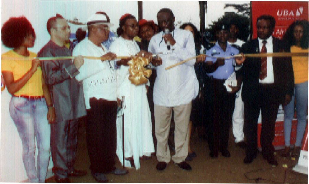 Former PHCCIMA President and FOSSCCIMA President, Prince Billy Gillis Harry (middle), representing NACCIMA president, cutting a tape during the official opening of 2014 Port Harcourt International Trade Fair in Port Harcourt. With him are President, PHCCIMA, Engr Emeka Unachukwu (right), former president of the chamber, Dr Vincent Furo (2nd left) and Chief Nabil Saleh (left)Photo: Egberi A. Sampson