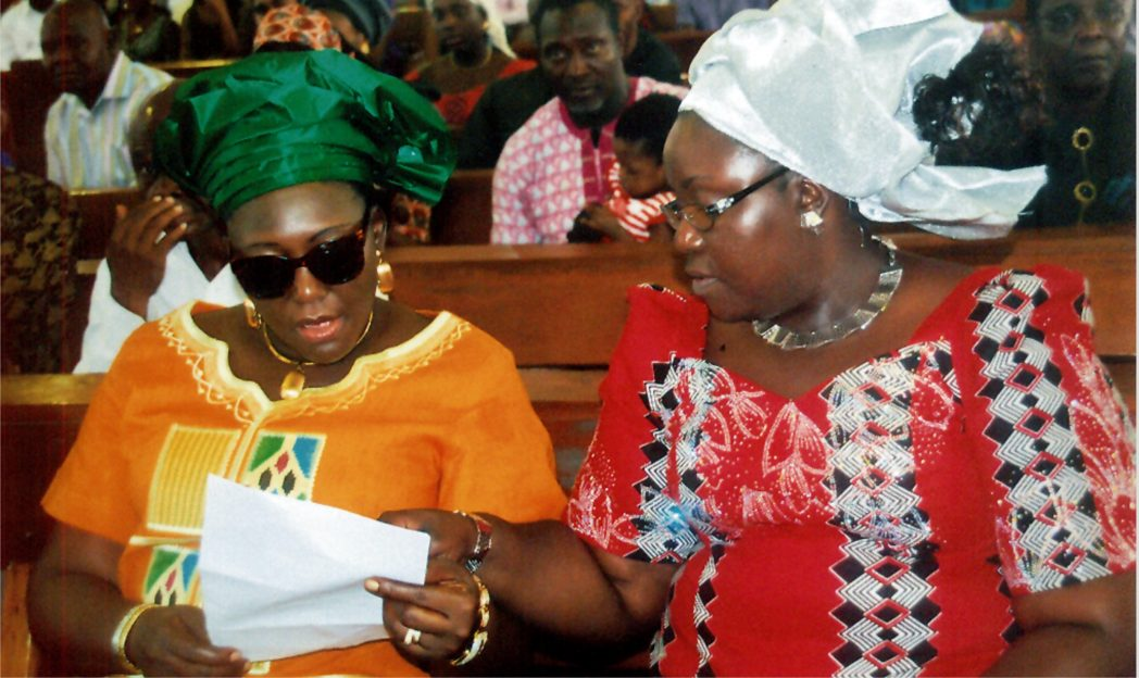 Rivers State Commissioner for Information and Communications, Mrs Ibim Semenitari (right) reviewing a document with the ministry's outgoing Permanent Secretary, Mrs Cordelia Peteside, during the 2015 thanksgiving service, yesterday in Port Harcourt.       Photo:Prince Dele Obinna