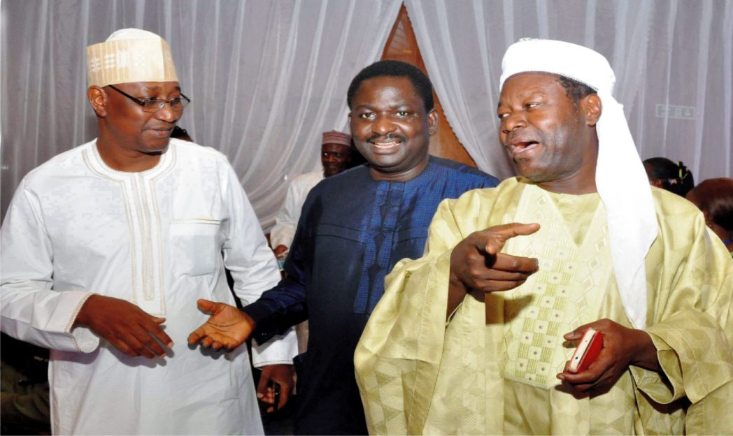 NUJ President, Malam Mohammed Garba, President, Nigerian Guild of Editors, Mr Femi Adesina and Commissioner for Information, Sokoto State, Malam  Danladi Bako, at the Nigerian Guild of Editors' fund-raising dinner for the building of editors' plaza in Abuja, recently.