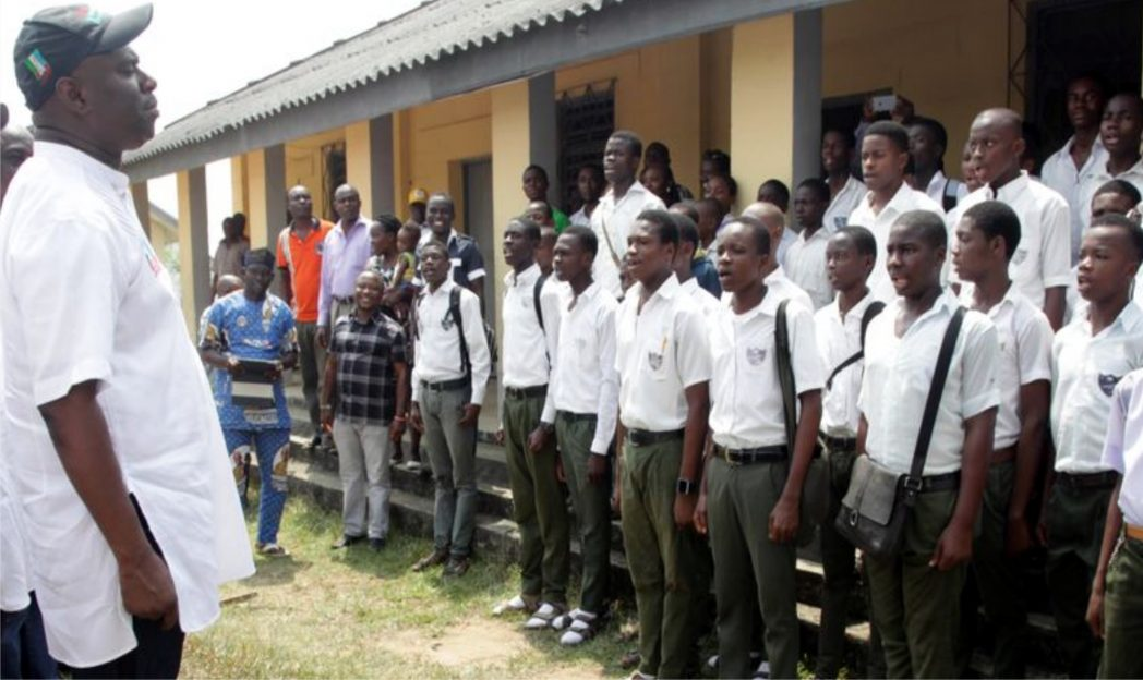 Rivers APC governorship candidate, Dr Dakuku Peterside (left) addressing students and teachers at Okrika National Grammar School, Okrika, during a pre-campaign rally visit to the school yesterday