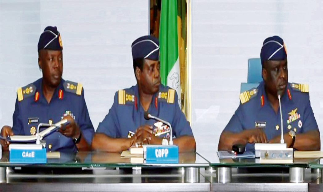 Representative of the Chief Of Aircraft Engineering, Air Commodore Kayode Beckley; Chief of Air Staff, Air Marshal Adesola Amosu and Chief of Policy and Plans, Avm James Gbum, at a media briefing on Commemoration of the 50th Anniversary of the Nigerian Air Force in Abuja recently.