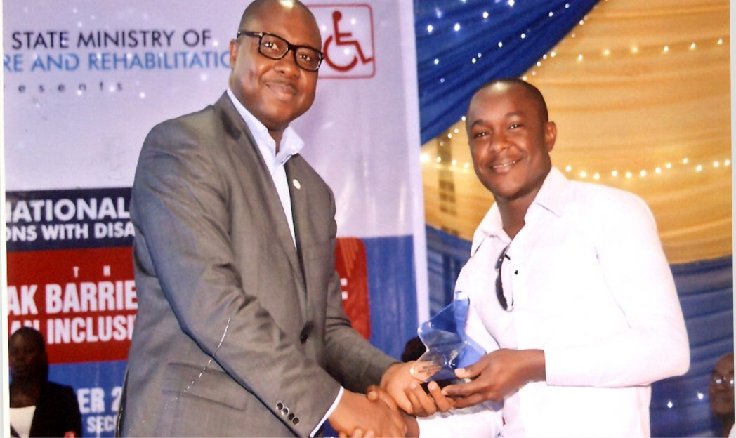 Executive Director, RSSDA, Noble Pepple (left) presenting a souvenir to a  Ist Class Law graduate of Rivers overseas scholarship scheme, Daniel Nlemogu at an event in Port Harcourt, recently