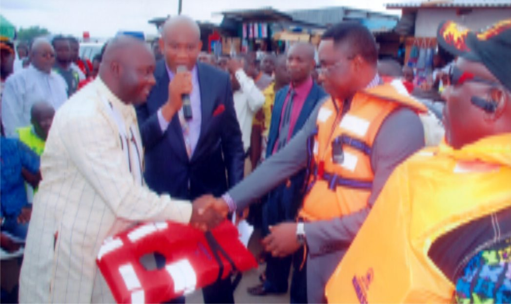 Eastern Zonal Co-ordinator, NIMASA, Mr  Anthony Ogedi (2nd right), presenting a life vest to the Chairman of maritime workers, Bonny Unit, Hon Israel Pepple, during a safety campaign organised  by NIMASA in  Port Harcourt recently.