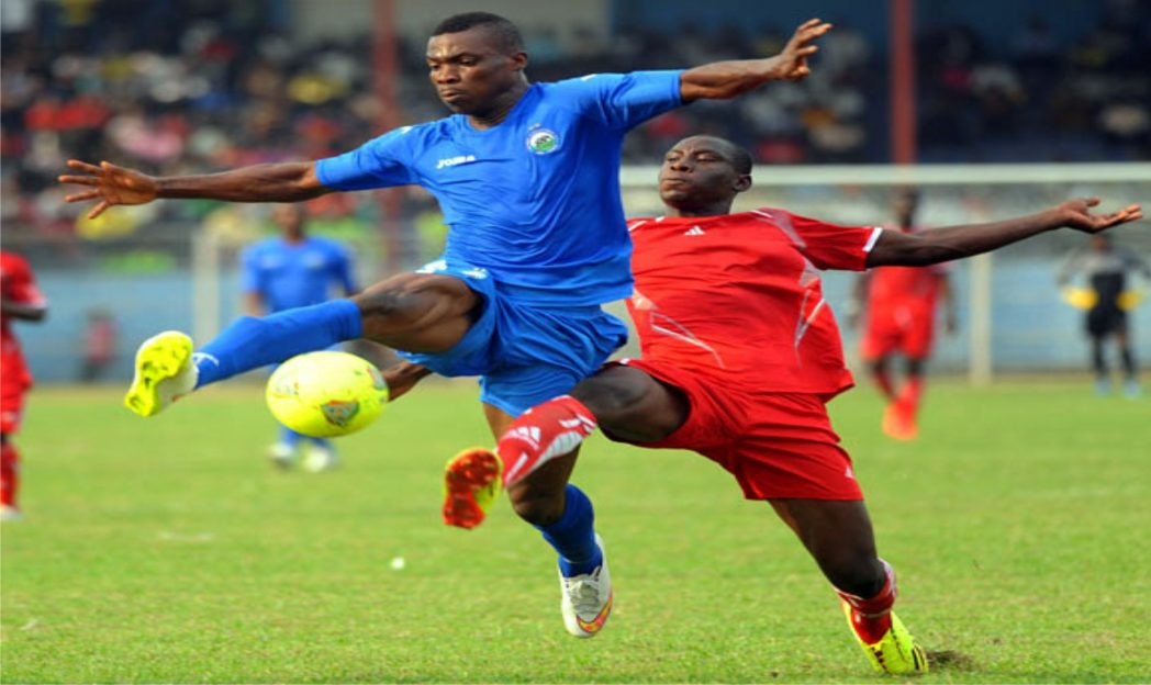 Enyimba's Daniel Etor (left) being pressurised by a Buffles du Borgu player last Sunday in Aba.