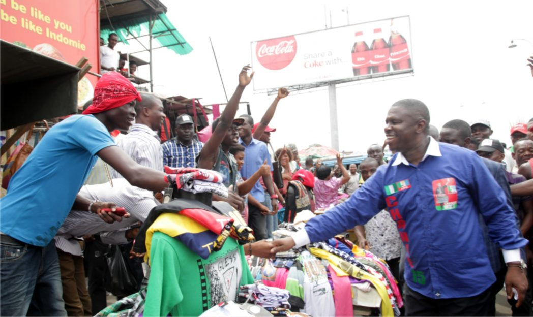 APC governorship candidate in Rivers State, Dr. Dakuku Peterside, shaking hands with enthusiastic traders at the popular Mile 3 Market in Port Harcourt, recently.