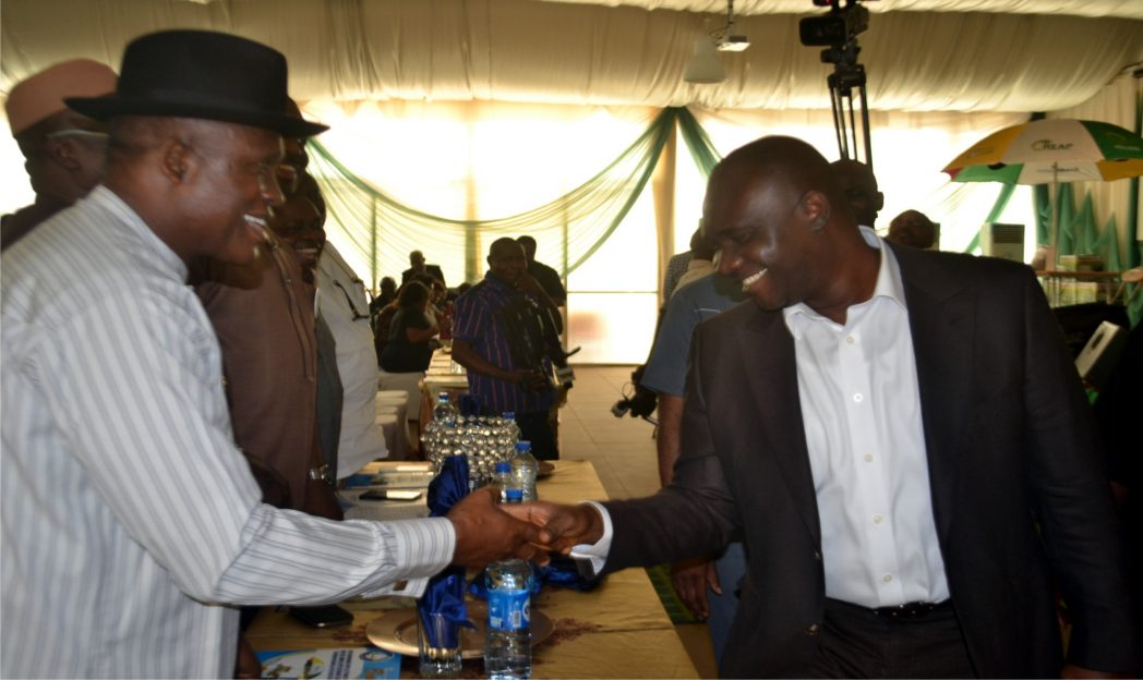 Representative of the Managing Director/Director, Project, NDDC, Engr. Tuoyo Omatsuli (right) in a hand shake with NDDC Rivers Representative, Chief Ephram Sobere Etete during the Youth Empowerment Programme organised by the commission recently in  Port Harcourt.        Photo: Nwiueh Donatus Ken