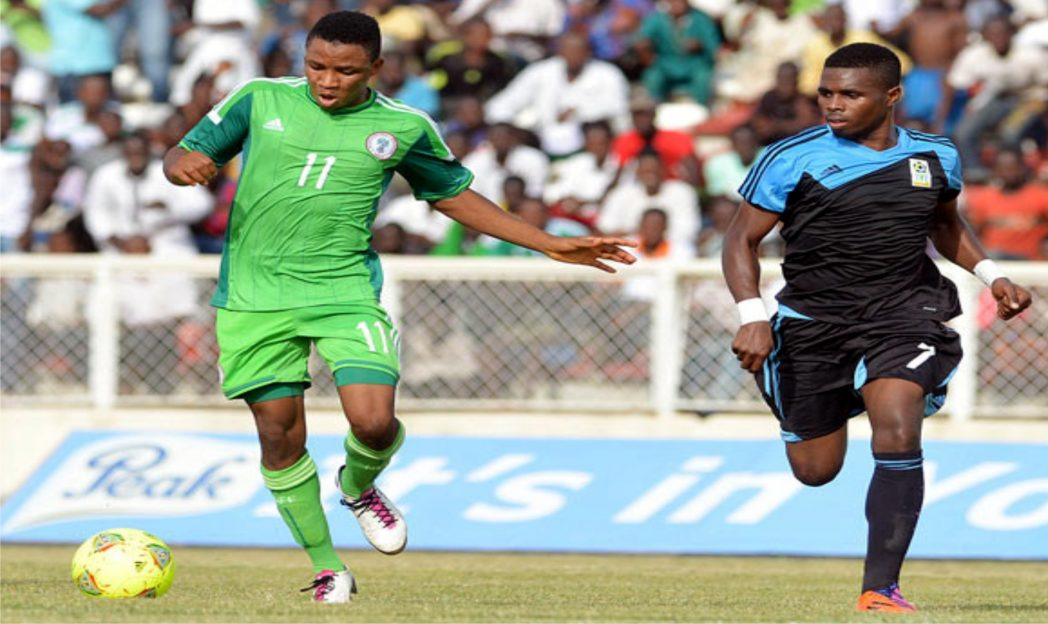 A Flying Eagles player (11) trying to outwit an opponent.