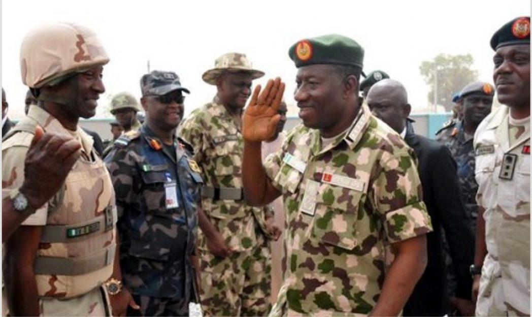President Goodluck Jonathan (2nd right), saluting some gallant soldiers for their exploits during his visit to Mubi and Baga in Borno State, yesterday