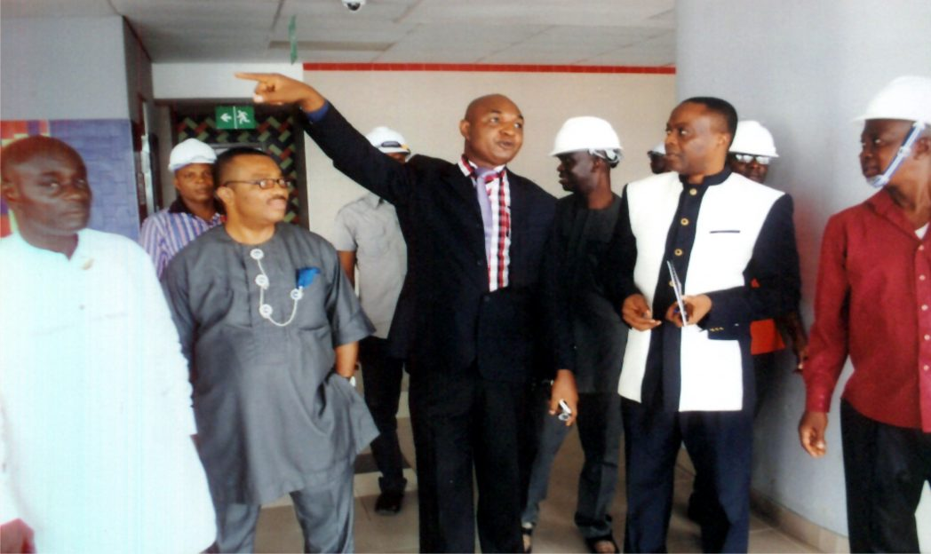 Permanent Secretary, Rivers State Ministry of Information and Communications, Sam Woka (middle) explaining a point during an inspection of the state  monorail project at UTC station, last Wednesday. With him are General Manager, RSNC, Mr Celestine Ogolo (2nd left),a Director in the Ministry of Information and Communications, Pastor Paulinus Nsirim (left), and other dignitaries.