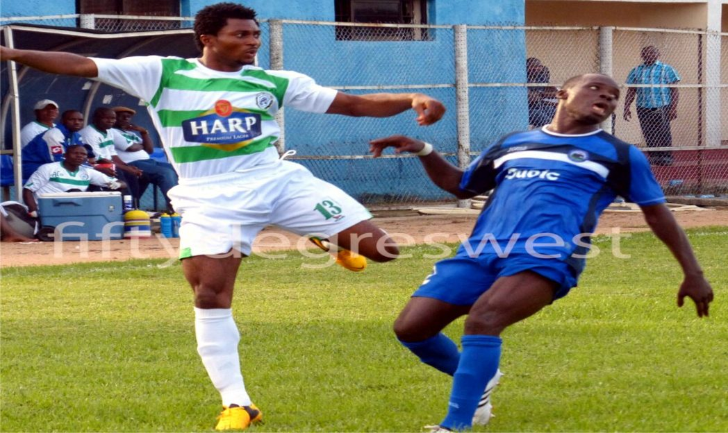 A Dolphins attacker (left) against an Enyimba opponent in a Glo Premier League game, last weekend.