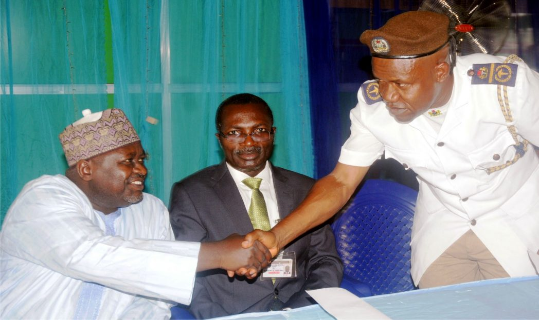 Director, Pollution Control, Ecological Funds Office, Mr Shaaibu Yakasai (left), in a handshake with the Deputy Director, Environmental Health Services Oyo State, Mr Jimoh Sabiu, at the public enlightenment on Medical Waste Incinerator Project of Ecological Funds Office in Ibadan last Thursday. With them is the Representative of Chief Medical Director, university college hospital, Dr Adefemi Afolabi