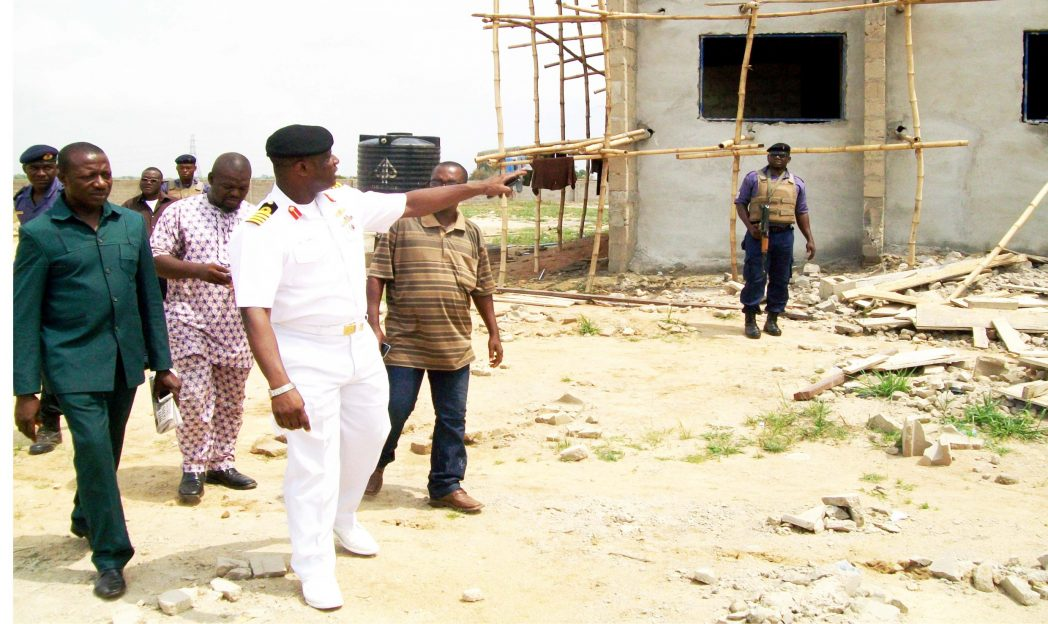 Commanding Officer,  Navy Out-post, Onitsha, Navy Capt. Mike Oamen, conducting newsmen  round the nearly completed new administrative building within the new Navy Base Complex  last Friday