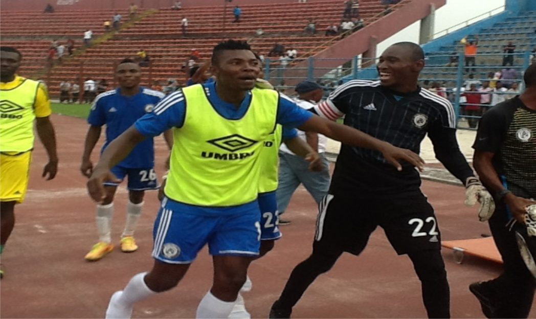 Dulphins skipper, Sunday Rotimi (22) leads team mates in celebrations after overcoming Vegetarians via penalty shootout