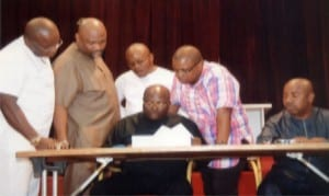 L-R: Hon Josiah Olu, Hon. Chidi Lloyd, Speaker of the House, Rt Hon. Otelemaba, Amachree (middle sitting), Hon. Augustine Ngo (3rd right), Hon. Victor Amadi (2nd right) and Deputy Clerk, Mr. Lekie Dumnu, during the passage of the 2015 State Budget in Port Harcourt last Wednesday.                                                          Photo: Chris Monyanaga