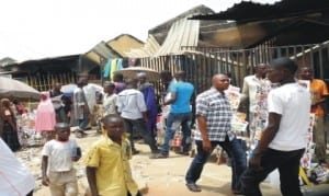 Some Traders at a burnt market in Hong, Adamawa State, during a media tour of territories recovered by Nigerian troops from insurgents in Hong.