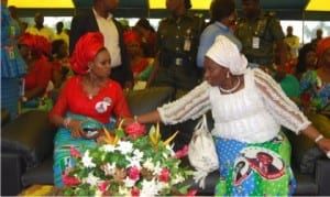Wife of APC governorship candidate in Rivers State, Barr. (Mrs.) Elima Peterside,  discussing with  wife of Executive Governor of Rivers State, Dame Judith Amaechi, during a town hall meeting with women at Emohua LGA