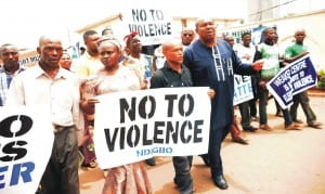 Founder, Igbo Youth Movement (IYM), Comrade Elliot Uko (left), with members of IYM and South-East Self Determination Coalition on a peaceful rally on violence free 2015 elections in Enugu recently.           Photo: NAN