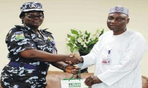 The New Commissioner of Police, Murtala Muhammed Airport, Dorothy Gimba (left), with the Managing Director, Federal Airports Authority of Nigeria (faan), Mr Saleh Dunoma, during her courtesy visit to faan's Managing Director in Lagos.                   Photo: NAN