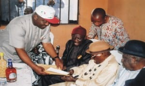 Governship candidate, of  Peoples Democratic Party (PDP), Rivers State, Chief Nyesom E. Wike (left), presenting a car document to the Paramount Ruler  of Rumuwoji community, Chief John Dike in the community, yesterday .                                                                                                                                                                     Photo: Obinna Prince Dele.