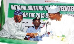 Election and Party Monitoring Committee, Prof. Lai Olorode (left), in  handshake with Chairman, Independent National Electoral Commission, Prof. Attahiru Jega, during the national briefing of accredited observers for the 2015 General Election in Abuja, yesterday. With them is the Inspector General of Police, Suleiman Abba.