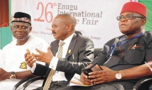 L-R: Representative of Acting Executive Chairman, Federal Inland Revenue Service (FIRS), Mr Obri Ogar; President, Enugu Chamber of Commerce, Industry, Mines and Agriculture (ECCIMA), Dr Ifeanyi Okoye and ECCIMA Vice President, Works, Mr Nonye Osakwe, during FIRS Special Day  at the 26th ECCIMA International Trade Fair in Enugu, recently. Photo: NAN.