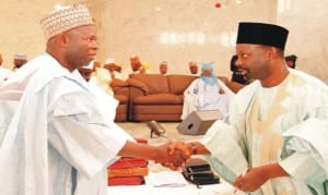 Governor Ibrahim Dankwambo of Gombe State (right), congratulating a newly appointed Permanent Secretary, Mr Renos Kabiny, during the swearing-in of six permanent secretaries and Six Special Advisers in Gombe State, recently.                                         Photo: NAN