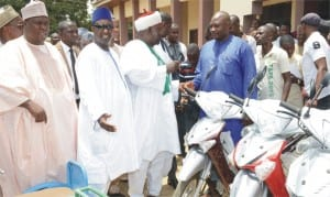 The District Head of Gabasawa, Alhaji Jibrin Mohammed, presenting  keys of a motorcycle to one of the beneficiaries of Umar Sani Foundation's 2nd Youth Empowerment Programme in Kaduna, yesterday. With them are Governor Ramalan Yero of Kaduna State (2nd left) and the sponsor and Senior Special Assistant to the Vice President on Media and Publicity, Umar Sani.