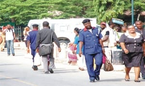Civil servants resuming duty after Easter holidays at the Federal Secretariat in  Abuja, yesterday.