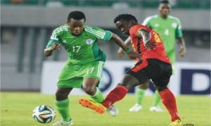 Nigeria's Ogenyi Onazi (17) in contest with a Ugandan opponent, during their recent friendly in Uyo, Akwa Ibom State
