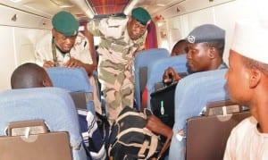 Director, Defence Information, Brig.-Gen. Chris Olukolade (3rd-left) after a surveillance on Chibok, recently.     Photo: NAN