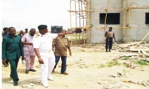 Commanding officer,  Navy out-post, Onitsha, Navy Capt. Mike Oamen, conducting  newsmen  round the nearly completed new administrative building within the new Navy Base Complex, recently.