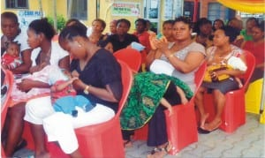 Mothers breast-feeding their babies in Port Harcourt.