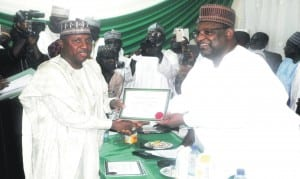 Adamawa State Governor-elect, Senator Bindow Jibrilla (left), being presented with Certificate of Return by the National Commissioner of INEC in charge of Adamawa, Gombe and Taraba States, Dr Nuru Yakubu, during the presentation ceremony in Yola last Saturday.                               Photo: NAN