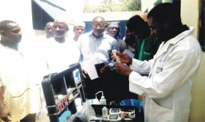 NAFDAC officials inspecting physic-chemical Microbiological Test Analysis of packaged water at the ongoing annual monitoring of water quality standard and compliance in Limawa village in Dutse Local Government of Jigawa State,  Wednesday