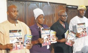 """L-R: Executive Director, Refocusing Nigerians Talents Organisation, Mr Abanka Musa, Mrs Olowu Esther, members, Refocusing Nigerians Talents Organisation, Dr Ayotunde Kehnde and Retired Col. Henry Ikoghode, presenting  books and magazine  on Strategic Advocacy and Promotions of Indigenous Inventors/Innovations for Wealth/Job Creation in Nigeria"""" in Abuja, recently."""