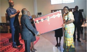 Chairman of the occasion/Chairman Civil Service Commission, Rivers State, Sir Ngo Martins-Yellowe (left) presenting a gift on behalf of Ministry of Information and Communications to the Commissioner, Mrs Ibim Semenitari, during her send-forth ceremony organised by the ministry in Port Harcourt, Monday. With them is the Perm Sec of the ministry, Sam Woka (left)