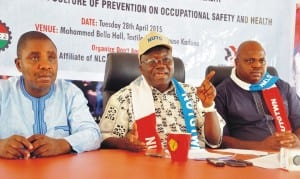 L-R:   Deputy General Secretary,  National Union of Textile Garment and Tailoring Workers of Nigeria, (Nutgtwn),  Comrade Sylvester Chimeeze, Secretary General,  Comrade Issa Aremu and National Treasurer, Comrade John Adaji, at  a news conference to mark World Day for Occupational Health and Safety in Kaduna, recently.